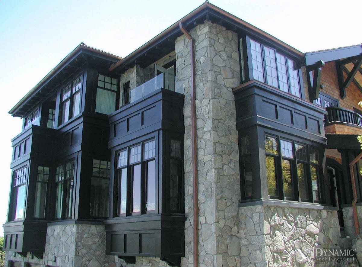 Traditional home with wood double hung windows