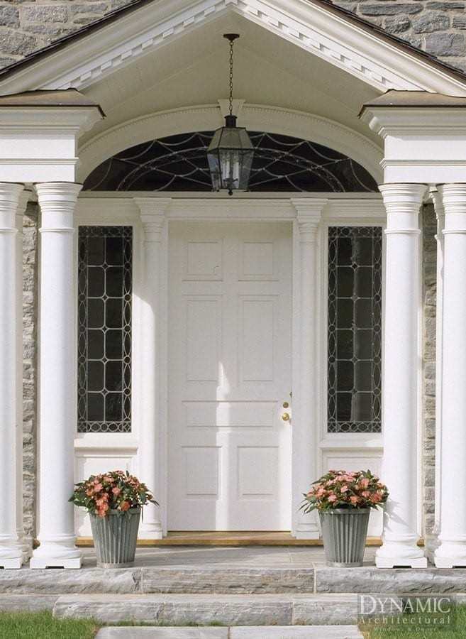Custom traditional wood entry door with arched transom and sidelites