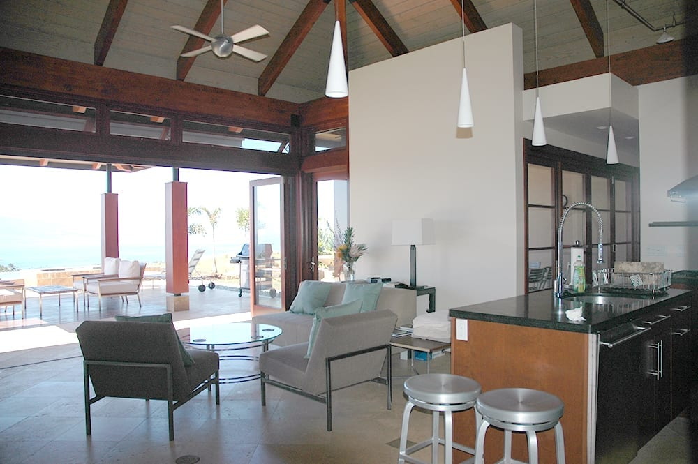 wood folding doors near kitchen in coastal Hawaii home